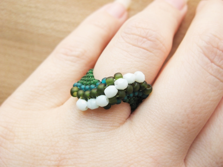 A ring made from seed beads and Czech crystals.