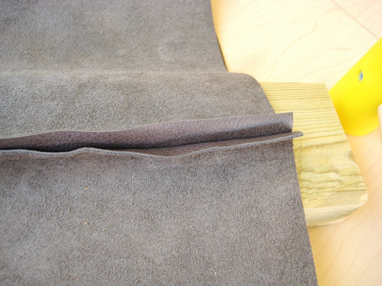 hammering a leather seam