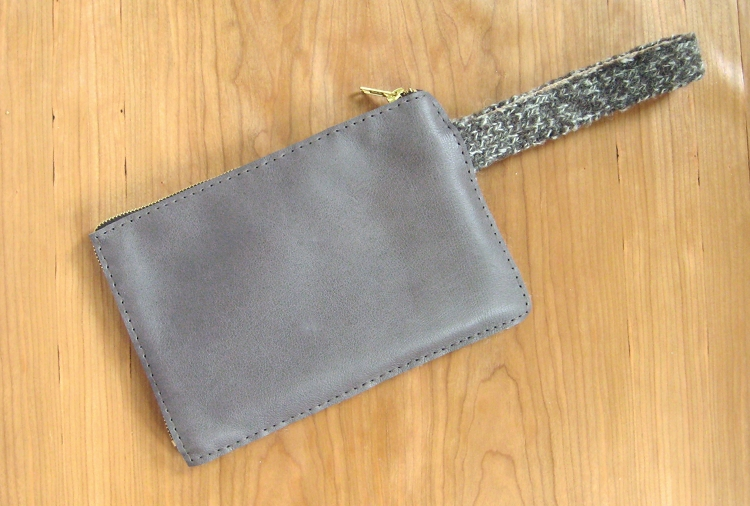 leather and wool clutch