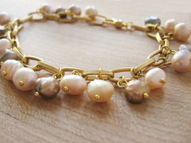 A Charm Bracelet Made With Freshwater Pearls