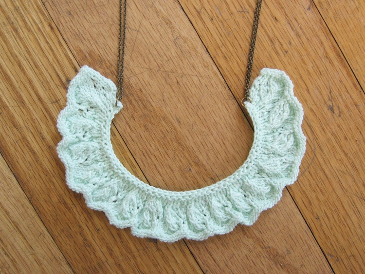Curved, ruched, knitted lace is perfect for a necklace.